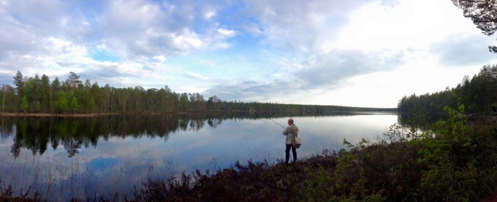 Fishing on a lake.