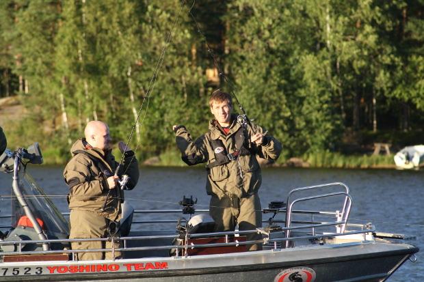 Two fishermen in a boat.